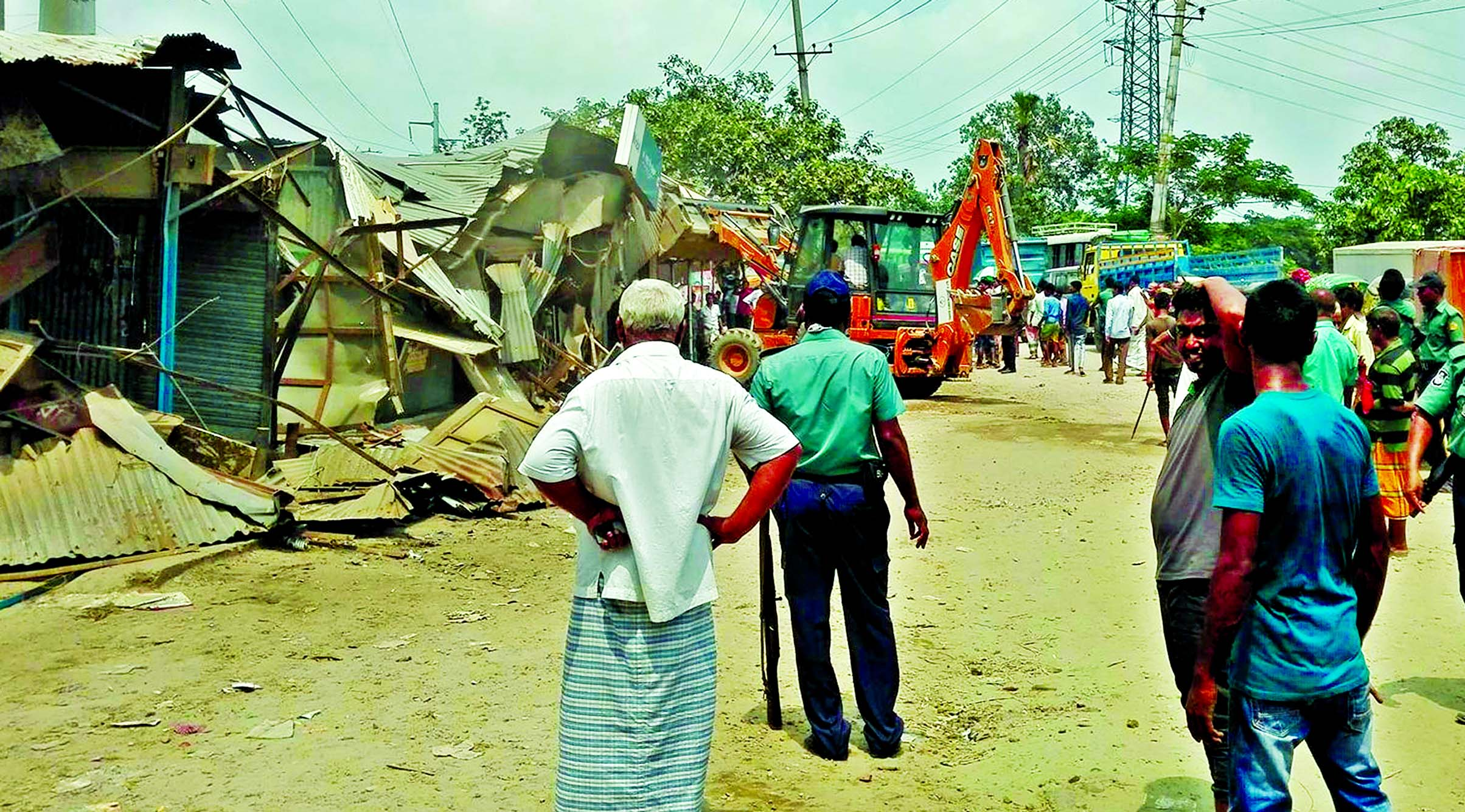 R & H Division, Dhaka District Administration and Rampura Traffic Zone jointly evicted unauthorized structures in Demra Staff Quarter area on Tuesday.