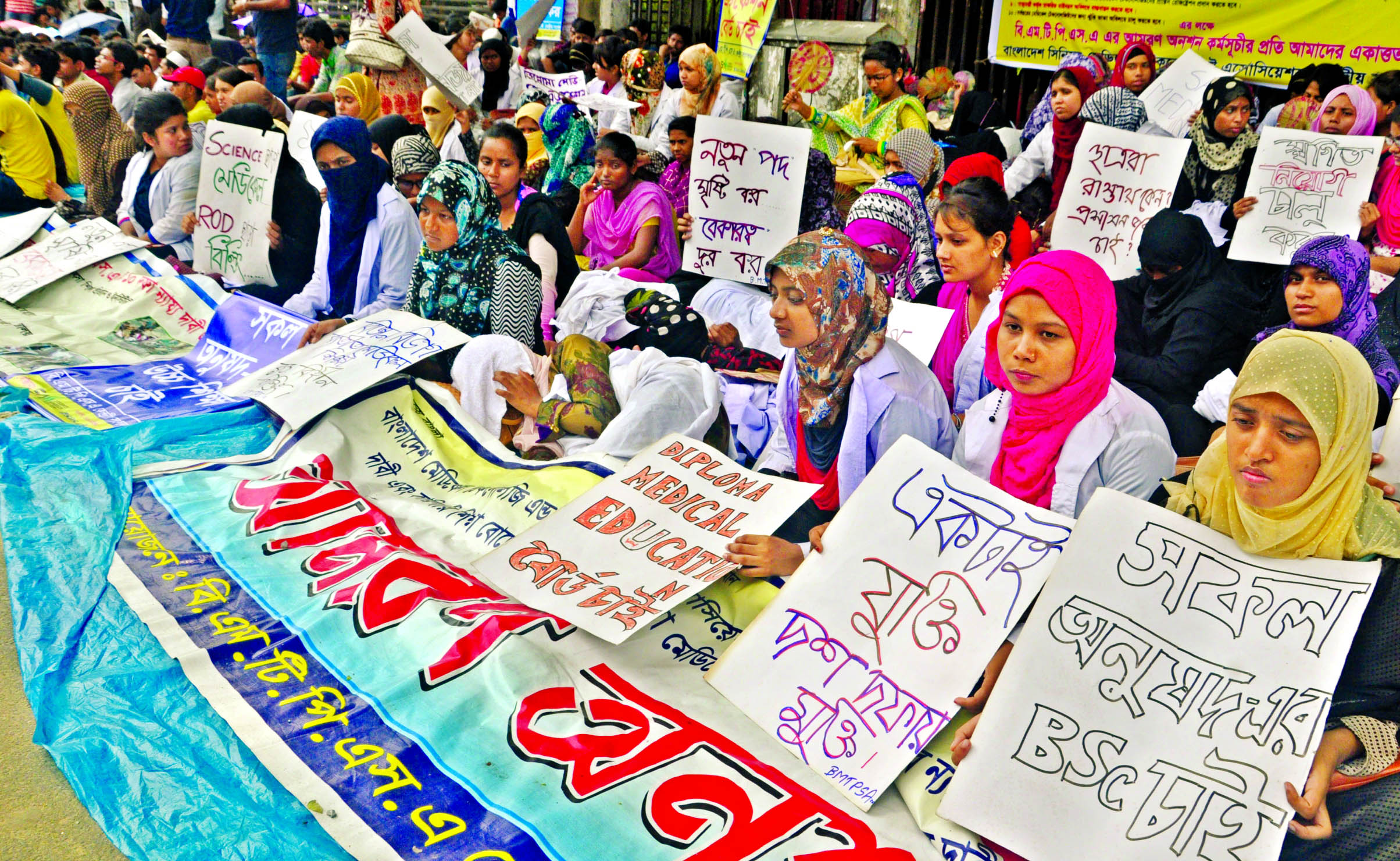 BMTPS members continuing their hunger strike in front of the Jatiya Press Club for implementing 10-point demands. This photo was taken on Tuesday.