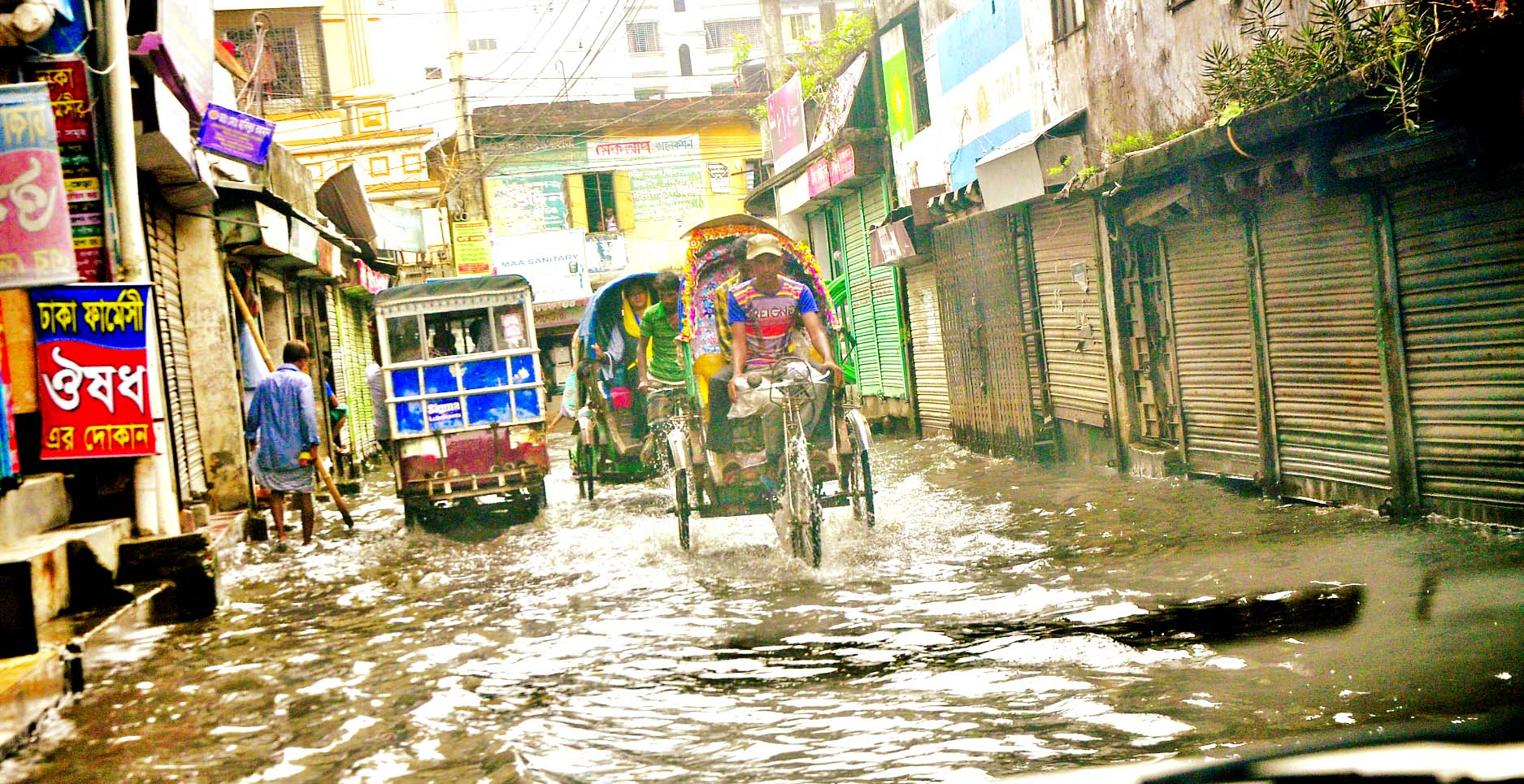Water-logging a regular phenomenon in city even after a short spell of rain due to poor drainage system causing sufferings to pedestrians and commuters. But the DSCC authorities seem to be indifferent to resolve the issue. This photo was taken from Jurain Commissioner Road on Sunday.